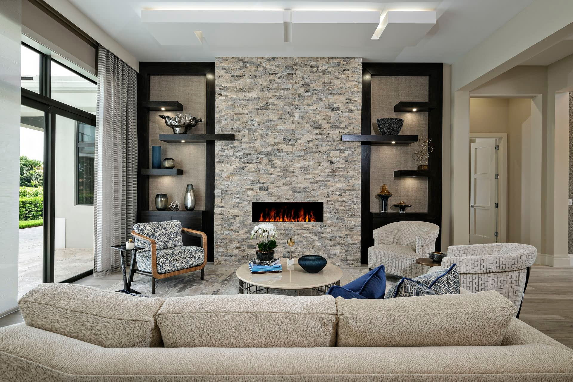 custom cabinetry modern stone fire place accent wall